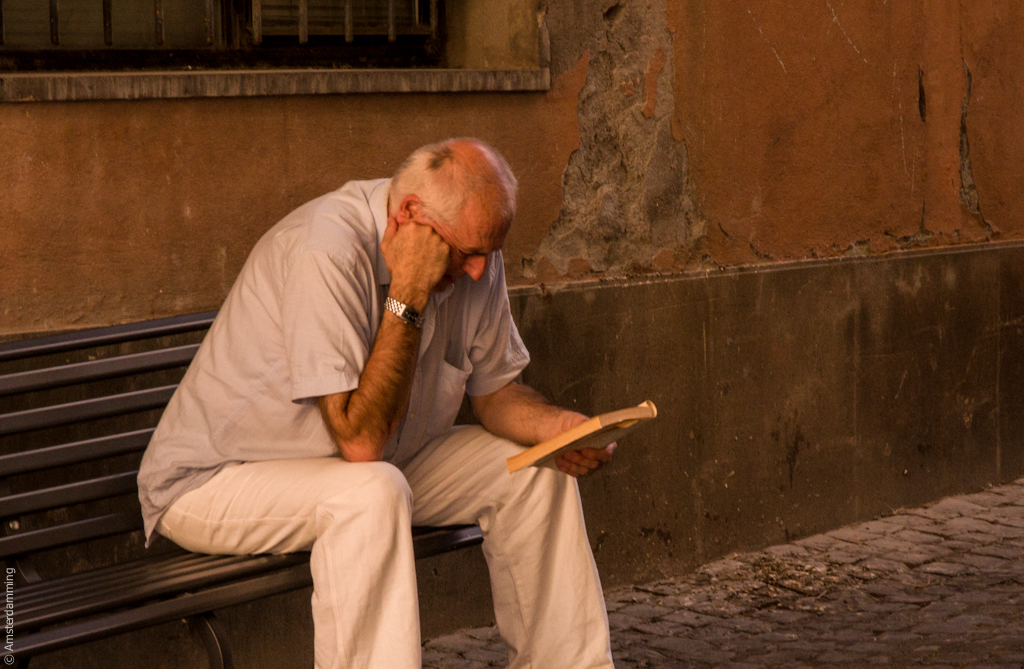 Italy, Man Reading in Orvieto