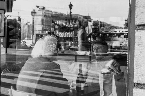 Friends speaking in a café on the Ile Saint-Louis, Paris by Photos-Change-The-World