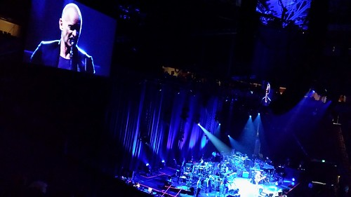 Sting, blue stage lighting, Paul Simon and Sting Concert, Key Arena,  Seattle, Washington, USA by Wonderlane