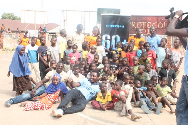 ANTHONY AGBOR EARTH HOUR COORDINATOR TARABA WITH CHILDREN DURING EARTH HOUR 2014