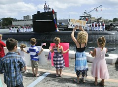 Family and friends welcome home the crew of USS City of Corpus Christi (SSN 705). (U.S. Navy/MC1 Steven Khor)