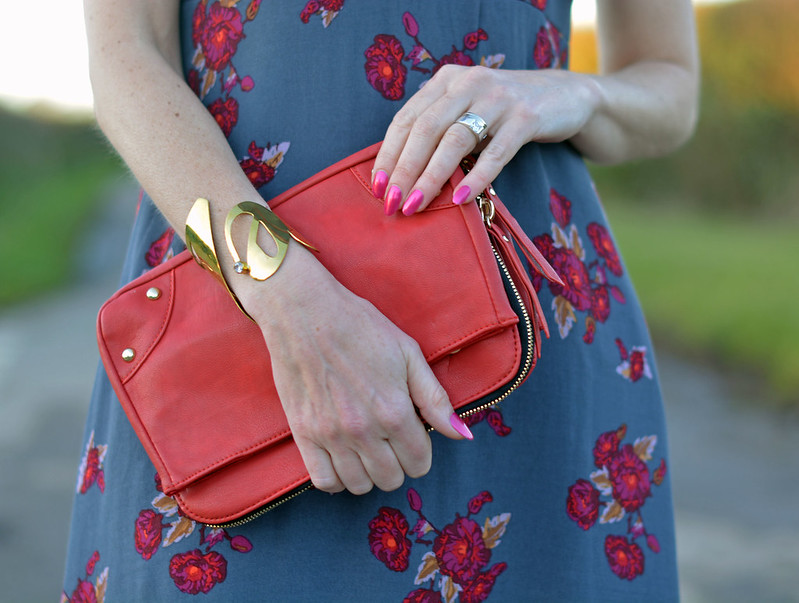 Valentine's Day date night outfit - rose patterned dress, red clutch