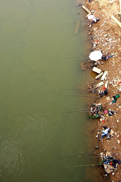 fishing beside a river, Nanning, Guangxi, China