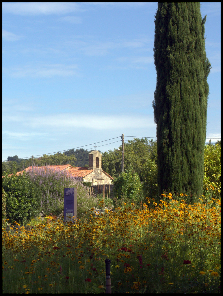 Paisaje con ermita y ciprés
