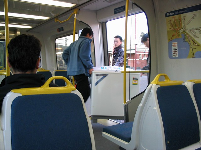 Taking home a washing machine on the train (May 2003)