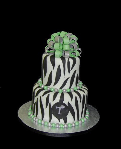 2 tier zebra print 50th birthday cake with green and silver accents