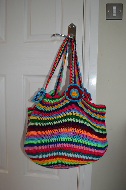 Rainbow crochet bag on door