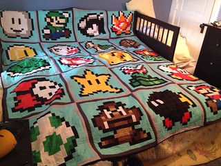 "Super Mario quilt finished.  QAL from Angela @ Cut to Pieces.  Extra blocks borrowed from others.  QAYG to make finishing possible at home.  80x100""."