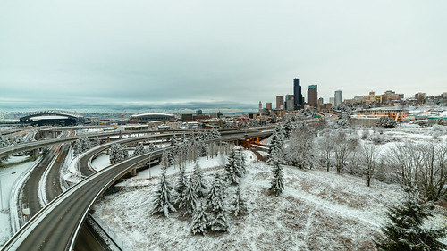 seattle city morning snow interstate90 highway freeway buildings cloudy downtown centurylinkfield safecostadium columbiatower drjoserizalbridge canon interchange skyline cityscape trees cliché iconic wideangle interstate5 traffic roads railing night canoneos5dmarkiii samyang14mmf28ifedmcaspherical johnwestrock