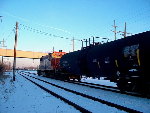 A former Grand Trunk Western locomotive pulling two tank cars to the CN Crawford Yard.at sunset.  Chicago Illinois.  February 2007. by Eddie from Chicago