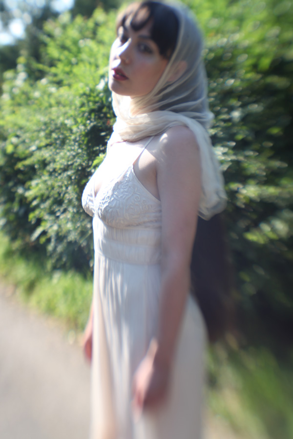 Gestalta photographed by Rebecca Tun. Dreamlike, melancholic photograph of a woman wearing a white head scarf