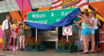 Unveiling William A. Koch Highway sign