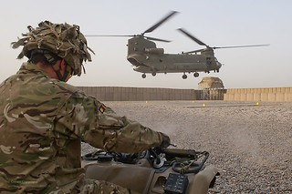 Soldier on Quad Bike Watching Chinook Landing in Afghanistan
