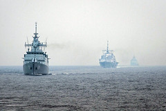 In this file photo, U.S. Navy and Royal Malaysian Navy ships operate together in the South China Sea during a previous CARAT exercise. (U.S. Navy/MC3 Karolina A. Oseguera)