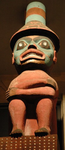 Chattering teeth - wow it's chilly, important person, tall hat, abalone eyes, ochre red, turquoise and black pigment, Tlingit, totemic design, northwest, Erna Gunther Ethnobotanic Garden, University of Washington campus, Seattle, Washington, USA by Wonderlane