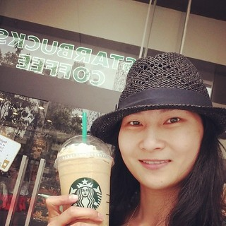 Cherie drinks starbucks in platinum mall, bangkok