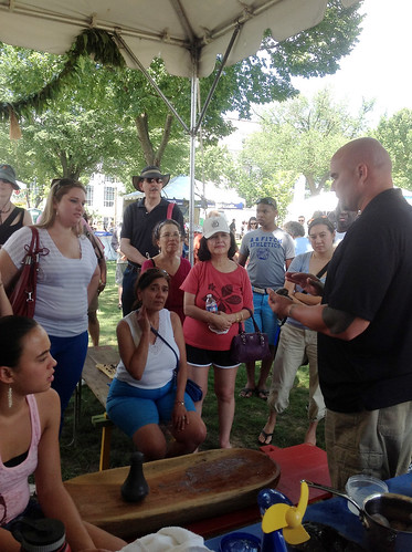 <p>Visitors learn about kalo, a staple of the Hawaiian diet at the University of Hawaii exhibit at the Smithsonian Folklife Festival.</p>