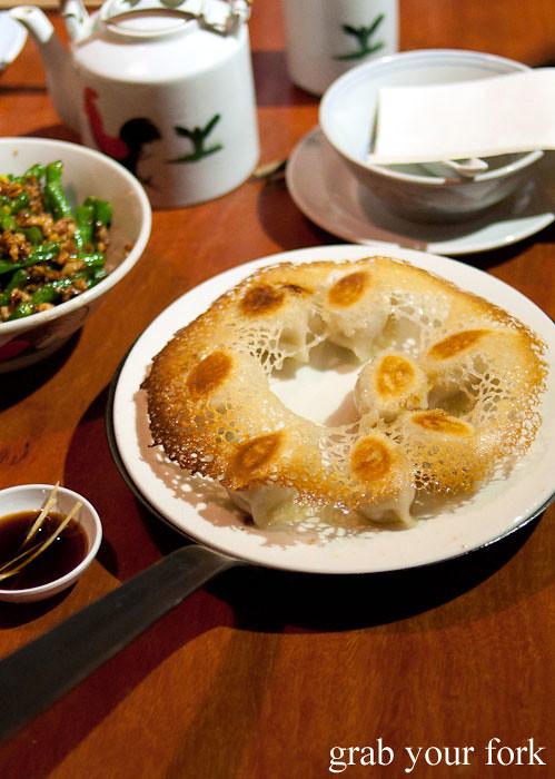 pan fried pork dumplings in birds nest