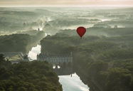 balloon over french chateau.