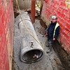 Colin Cowpe, Barhale operative, helping to lay a new sewer in Ossett.