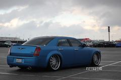 automobile(1.0), automotive exterior(1.0), executive car(1.0), wheel(1.0), vehicle(1.0), automotive design(1.0), chrysler 300(1.0), chrysler(1.0), sedan(1.0), land vehicle(1.0), luxury vehicle(1.0),