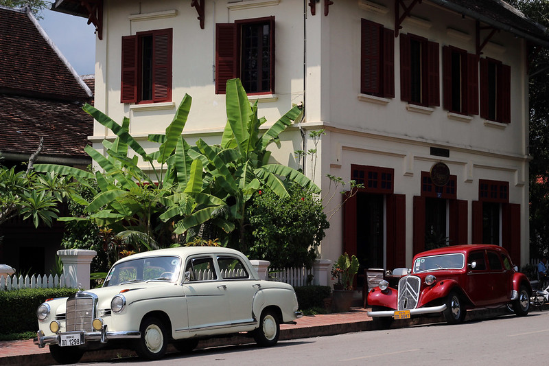 Vintage cars outside of a boutique restaurant in Luang Prabang's old city