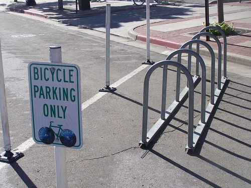 Street bicycle corral, 300 West next to Squatters, with a bicycle parking sign