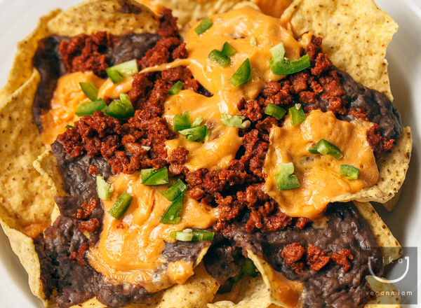 Vegan Slow-Cooked Black Beans Nachos with Daiya Cheddar Style Wedge, Soy Chorizo and Chopped Green Jalapeños