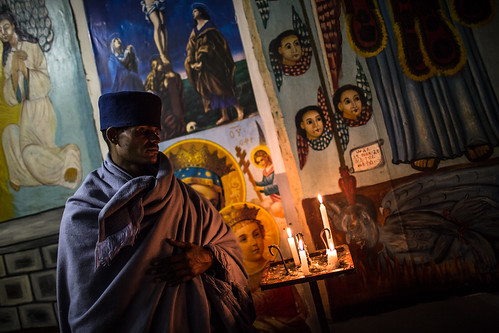 priest inside the monastery at debre Libanos by anthony pappone photographer