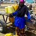 Ebyan Iftin rests after filling her jerry cans with water at a borehole in Dhobley by Oxfam East Africa