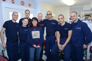 Coast Guard recruits from Golf and Foxtrot Companies 189 in basic training at Coast Guard Training Center Cape May, N.J., pose with Shelia Brown, a host with Operation Fireside, at her home in North Wildwood, N.J., Dec. 25, 2013. Operation Fireside pairs recruits who are in basic training for the holidays with a family to spend Christmas Day with before beginning training again later that day.  Coast Guard photo by Chief Warrant Officer Donnie Brzuska.