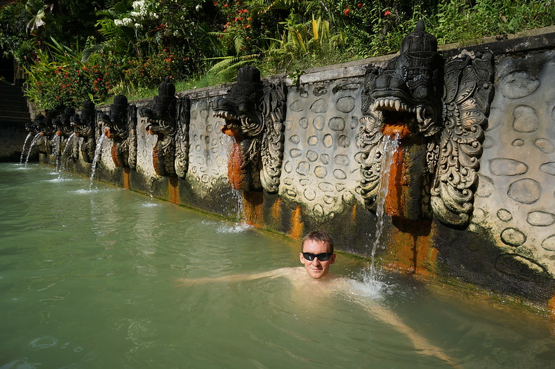 Carved in stone mouths ejecting hot water in Banjar Hot Springs, Bali