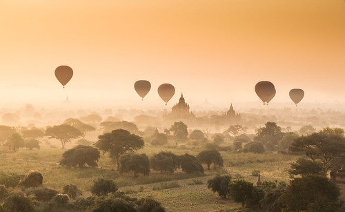 Myanmar (Burma) - Hot air balloons flying over misty Bagan at dawn
