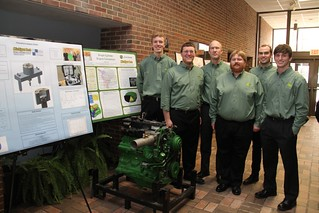 Single Cylinder Engine Conversion Team with poster