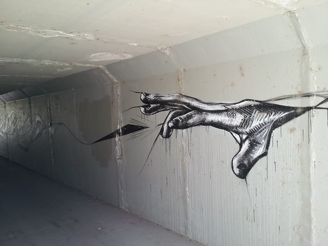a hand painted in an underpass (graffiti)