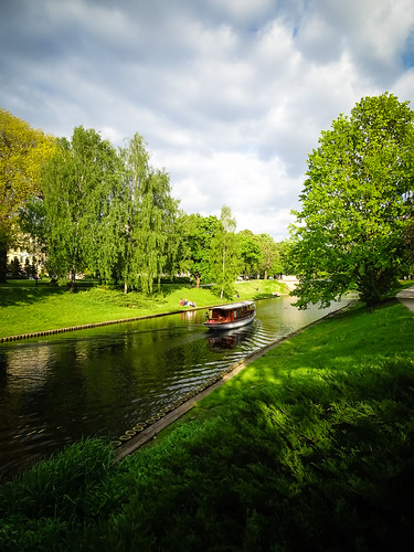 park city trees sky green nature grass clouds river landscape boat spring outdoor sunny latvia riga