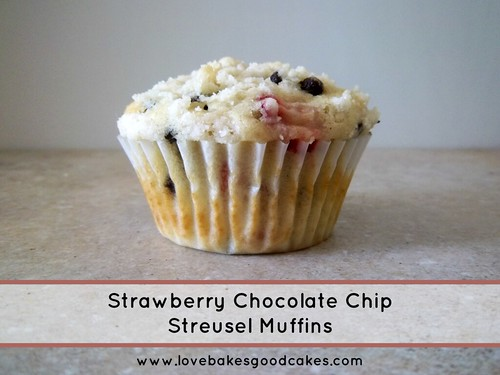 Strawberry Chocolate Chip Streusel Muffins in wrapper on counter top.