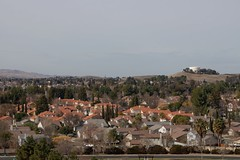 Klaus Naujok posted a photo:	From the cell tower hill above Meadow Creek Park, a view of my neighborhood towards the Water tower, where I took yesterday's photos from. Photo taken with the Konica Minolta AF DT 18–70mm @ 70mm (105mm FF).