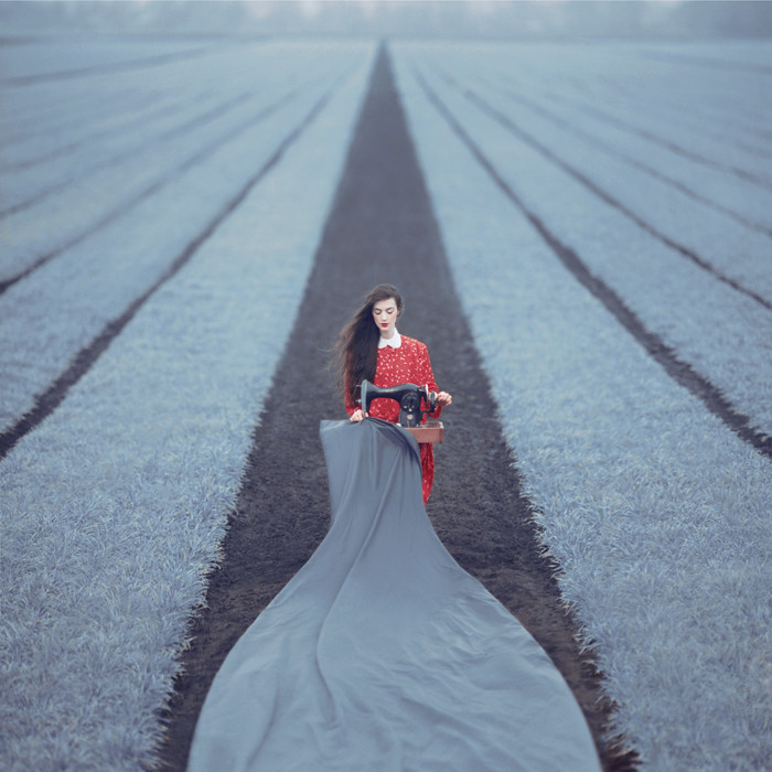 conceptual photo of a girl in the field by oleg oprisco