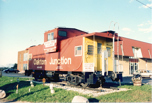 The Oakton Junction commercial real estate caboose on Oakton Street.  Des Plaines Illinois.  October 1988. by Eddie from Chicago