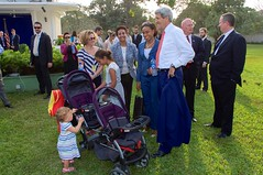 U.S. Secretary of State John Kerry speaks to staffers and family members he just addressed at the U.S. Consulate General's Residence in Lagos, Nigeria, after the Secretary met with Nigerian President Goodluck Jonathan and his re-election challenger, retired Major-General Muhammadu Buhari, in Lagos on January 25, 2015, for conversations urging both candidates to accept the results of their upcoming general-election vote. [State Department Photo/Public Domain]
