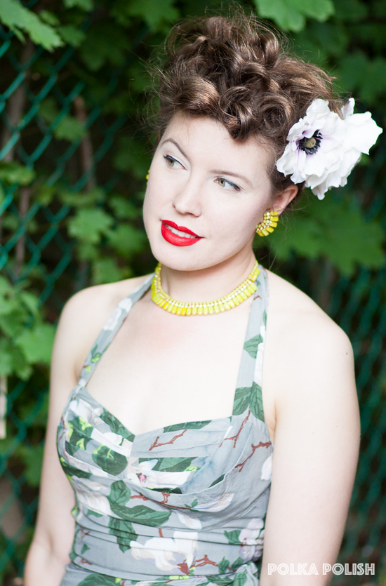 Vintage chartreuse rhinestone jewelry and red lipstick make this subtle-toned summer outfit pop