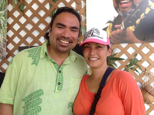 <p>The University of Hawaii delegation coordinator Aaron Sala and his wife Makanani stop for a moment to enjoy the festivities at the Smithsonian Folklife Festival.</p>