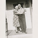 Small photo of Affectionate elderly couple hugs on the porch