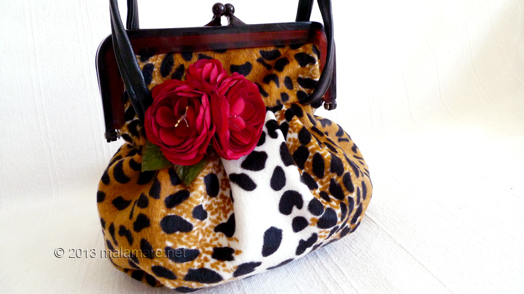 velvet handbag with leopard pattern