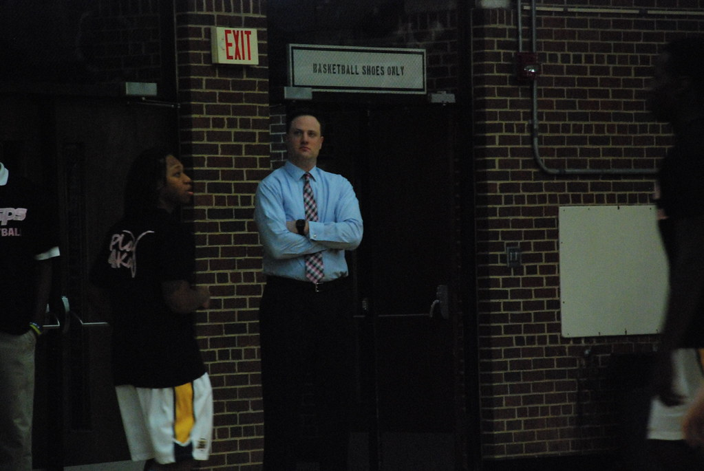 E&H head coach David Willson watches his team's warmups.