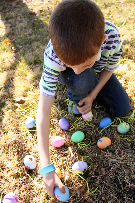 Egg-Hunt_Nathan-looking-at-his-eggs-on-ground