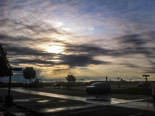 morning wet rain weather clouds sunrise slick parkinglot parking lot headquarters shining southwestairlines iphone lovefield swa hdq