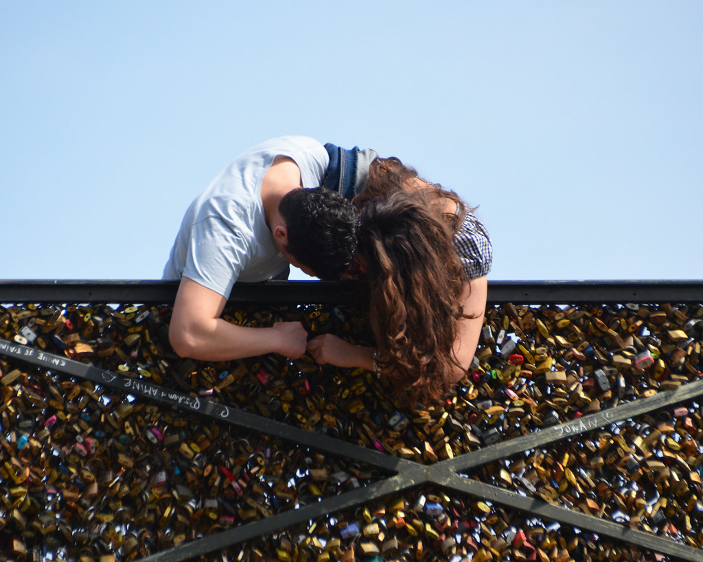 Adding one more love lock to the millions - Pont des Arts, Paris