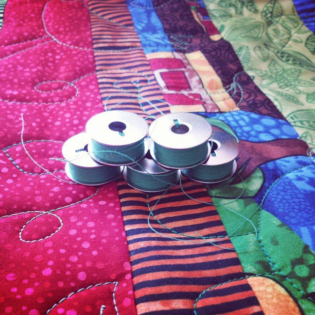 Loaded for bear! I've got 6 total bobbins wound (1 is in the machine), let's see how far I get on quilting the quilt made with @atwistedsister's fabrics before I have to wind more! #fbp